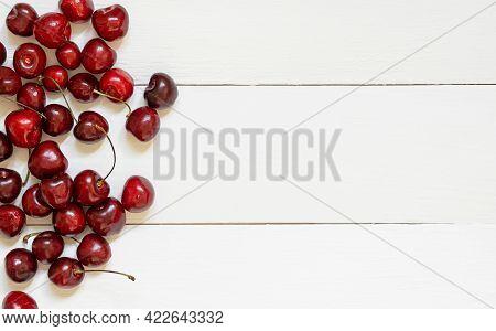 Fresh Cherry On Wooden White Background. Fresh Ripe Cherries.