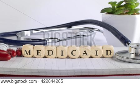 Medicaid Word With Building Blocks, Medical Concept Background.