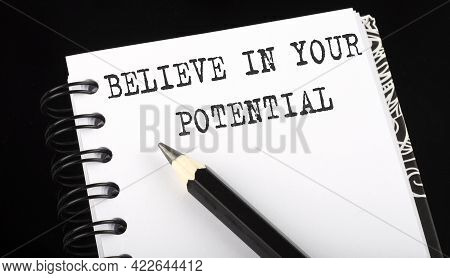 Believe In Your Potential Written Text In Small Notebook On Black Background