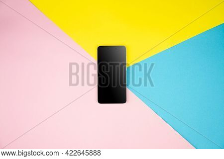 Mockup Black Blank Smartphone Screen Display On Yellow, Blue, Pink Background. Flat Lay, Top View. C