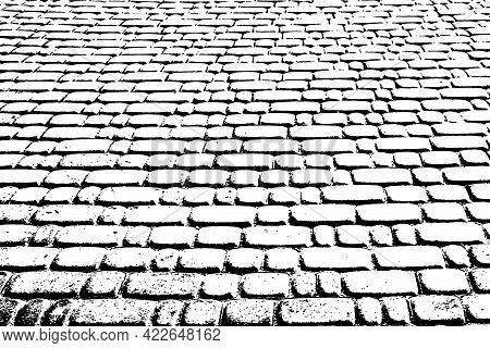 Grunge Texture Of Of An Uneven Paved Square. Monochrome Background Of Old Paving Stones In Perspecti