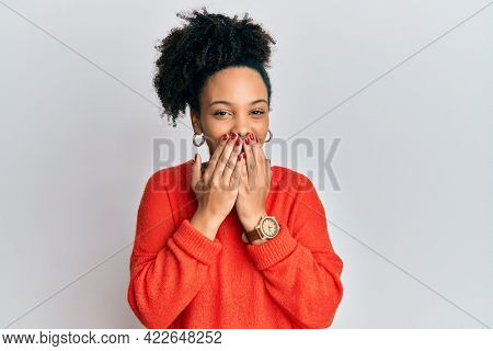 Young african american girl wearing casual clothes laughing and embarrassed giggle covering mouth with hands, gossip and scandal concept