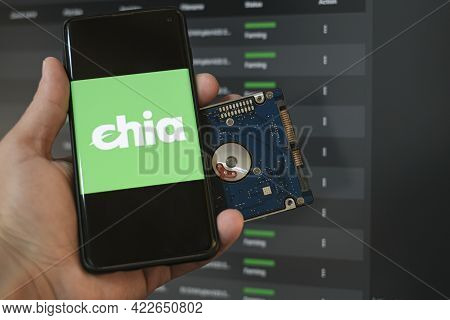Man Use New Green Crypto Currency Chia On A Smartphone, Hhd Storage Coin Mining Farming