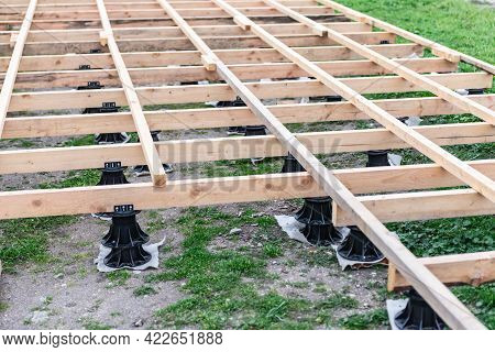 Wooden Crate For Paths. Arrangement Of The Substrate For Wooden Pavement. Special Plastic Stands For