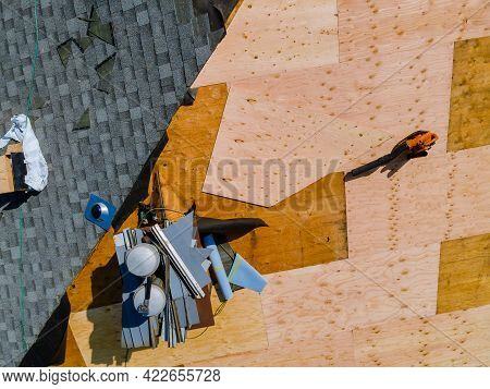 A Worker Replace Shingles On The Roof Of A Home Repairing The Roof Of A Home