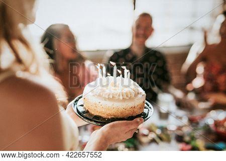 Bringing up the birthday cake