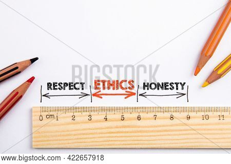 Ethics, Respect And Honesty Concept. Wooden Liner With Colored Pencils On A White Background