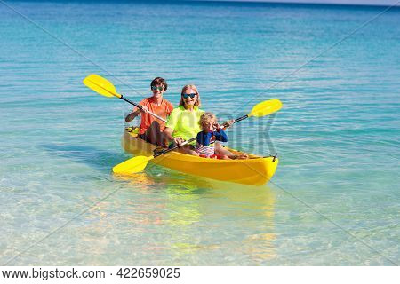 Kids Kayaking In Ocean. Children In Kayak In Tropical Sea. Active Vacation With Young Kid. Little Bo