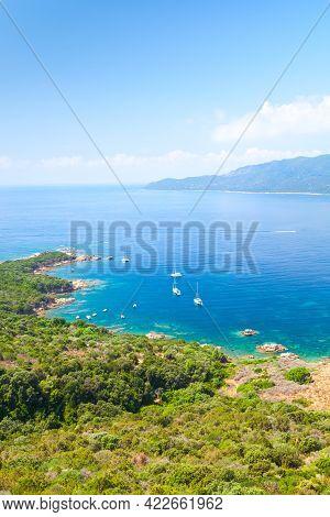 Corsica Island, Cupabia Gulf. Summer Landscape With Pleasure Motor Boats Moored Near Rocky Coast Bea