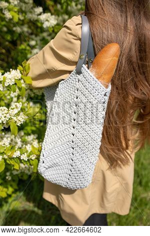 Girl Is Holding Mesh Shopping Bag With Baguette Without Plastic Bags. Zero Waste, Plastic Free Conce