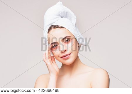 Young Woman Applying Eye Patches. Beautiful Girl With Silicone Eye Patches. Facial Care At Home. Gir