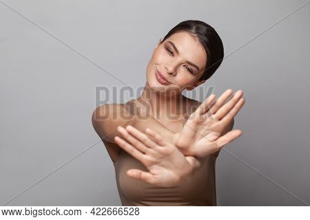 Positive Optimistic Woman Showing Stop Gesture And Refuses Wrinkles And Aging