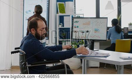 Disabled Immobilized Invalid Businessman Working At Financial Project Respecting Deadline Typing On