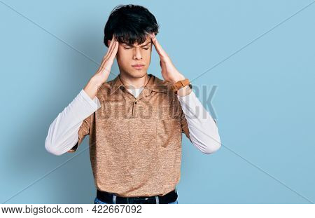 Handsome hipster young man wearing 90s retro style with hand on head, headache because stress. suffering migraine.