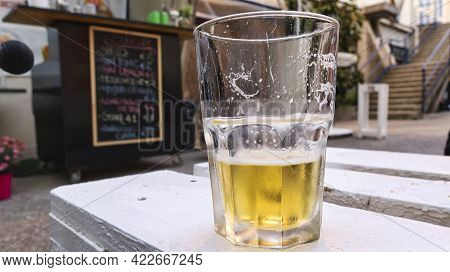 Mug Of Iced Beer On A Counter Of The Ligurian Riviera In Italy