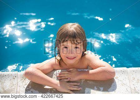Close-up Portrait Of Cheerful Child In Swimming Pool. Cute Joyful Little Boy Kid. Close Up Portrait