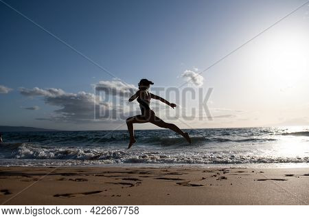 Woman Running On The Beach. Healthy Woman Run At Sea, Girl Doing Sport Outdoor, Happy Female Exercis