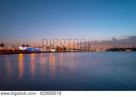 Miami City. Miami Skyline Panorama At Dusk With Skyscrapers Over Sea. Night Downtown Sanset.