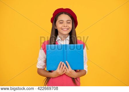 Dreamy Teen School Girl In French Beret Reading Book On Yellow Background, Imagine
