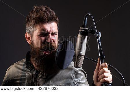 Karaoke Singer. Man Singing With Music Microphone.