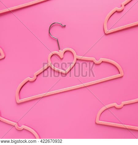 Black Friday Or Clothing Industry Concept On Pink Background Flat Lay With Randomly Scattered Pink C