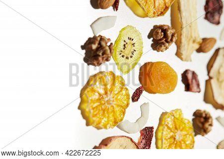 Close Up Of Healthy Food Dried Apples, Mango, Orange, Dried Apricots, Kiwi, Dried Coconut And Walnut