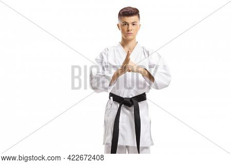Teenage boy in kimono exercising martial arts isolated on white background