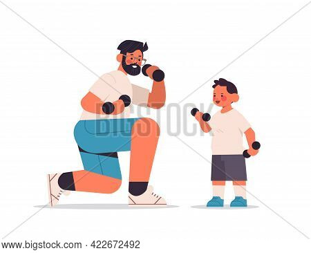 Young Father And Son Doing Physical Exercises With Dumbbells Parenting Fatherhood Concept
