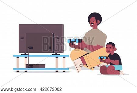 African American Father Playing Video Games On Game Console With Little Son Parenting Fatherhood Con
