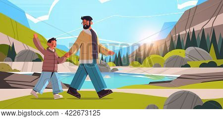 Young Father Walking Outdoor With Son Parenting Fatherhood Concept Dad Spending Time With His Kid