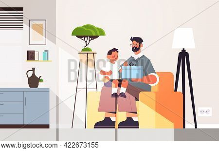 Young Father Holding Gift Box For Son Parenting Fatherhood Concept Dad Giving Holiday Present To His