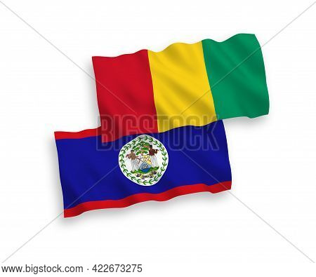National Fabric Wave Flags Of Belize And Guinea Isolated On White Background. 1 To 2 Proportion.