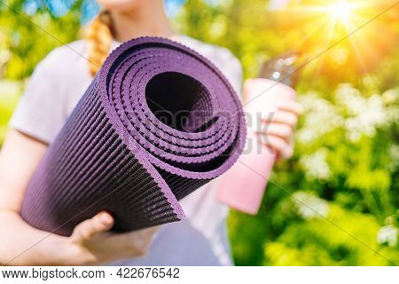 Sportswoman Going To Yoga Practice With Mat Being Ready For Exercising In Gym. Sporty Girl Holding Y