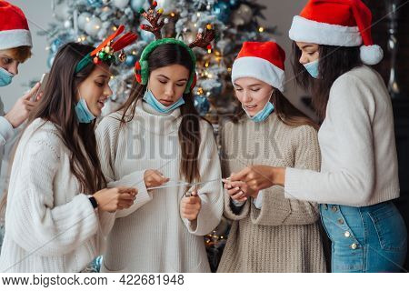 Multi-ethnic Young People Celebrating New Year Eve Holding Sparklers