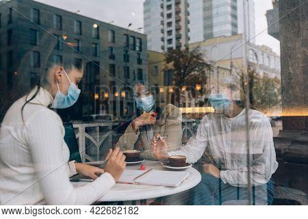 Friends Girls Met In A Cafe. Wear Medical Protective Masks.