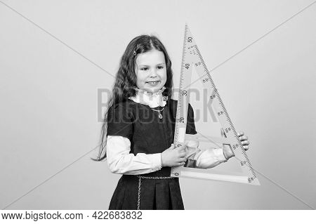 School Student Learning Geometry. Pupil Girl With Big Ruler. Stem School Disciplines. Small Girl Bac