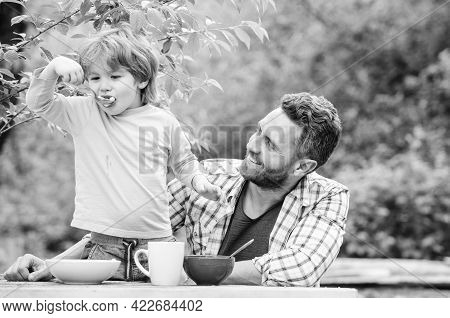 Healthy Food And Dieting. Childrens Day. Happy Fathers Day. Little Boy With Dad Eat Cereal. Summer M