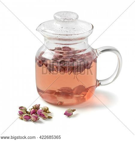 Glass teapot with dried rose buds tea isolated on white background