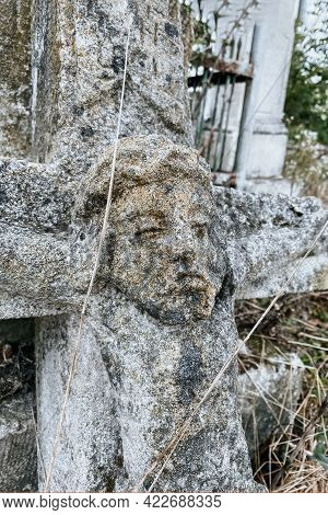 Vertical Image. Closeup View Of Unnamed Gravestone On Old Abandoned City Cemetery. Weathered Stone C