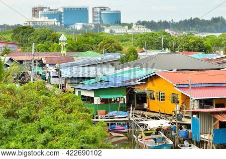 Labuan,malaysia-may 22,2021:the Village Of Fishermen With Houses On The Water And Fishing Boats With
