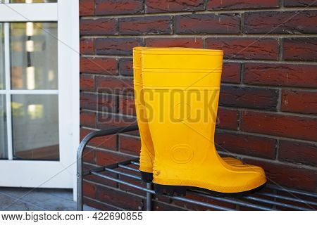 Rubber Boots Near The Entrance To The House