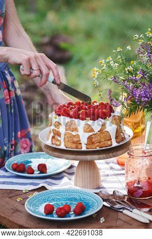 Colander With Strawberries In The Garden