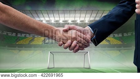 Composition of businessmen shaking hands over sports stadium. sports, deal, agreement and competition concept digitally generated image.