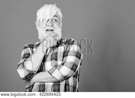 Senior Man With Long Bangs And Beard. Subculture And Lifestyle. Barbershop And Hairstylist. Expressi