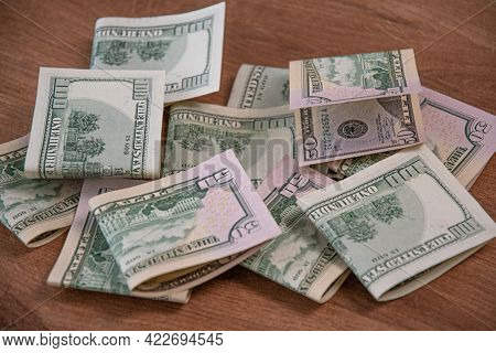 Mess Of Half Folded Us Dollar Paper Cash Banknotes. Money Cash Fifty Dollar And One Hundred Dollar B