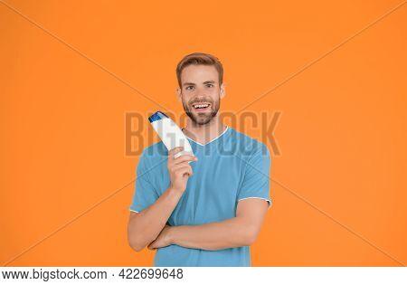 Stronger Hair. Man Handsome Hipster Hold Bottle Shampoo Shower Gel. Shampoo Conditioner For Men. Exp