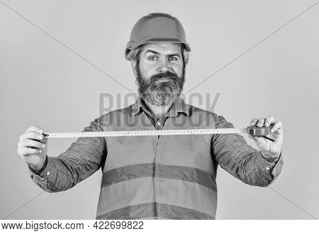 Hipster In Hard Hat. Make Measurements Apartment Renovation. Safety Engineer Measure Acceptable Para