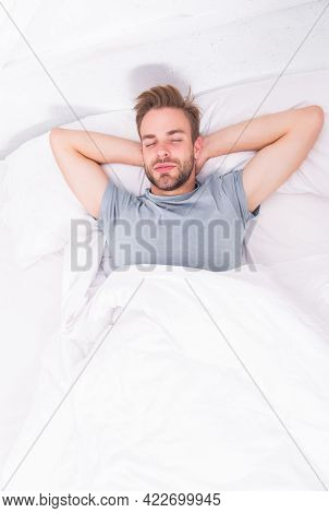 Handsome And Sleepy. Sexy Man Sleeping In Bed. Relaxing Man In Bedroom. Attractive Single Man Being