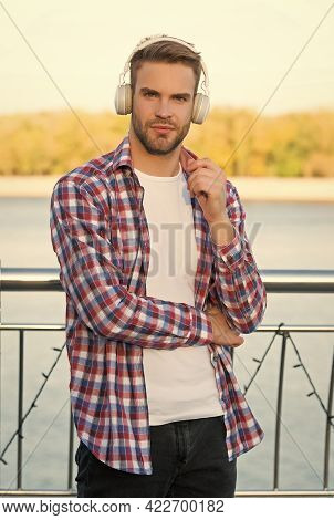 Just Relaxing. Modern Design Earphones. Listen To Music. Guy Casual Style Listening Ebook. Audio Boo