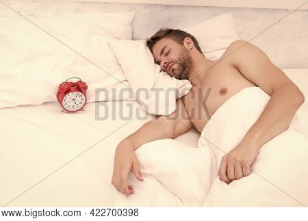 Man Sleeping Bed White Bedclothes And Red Alarm Clock, Deep Sleep Concept